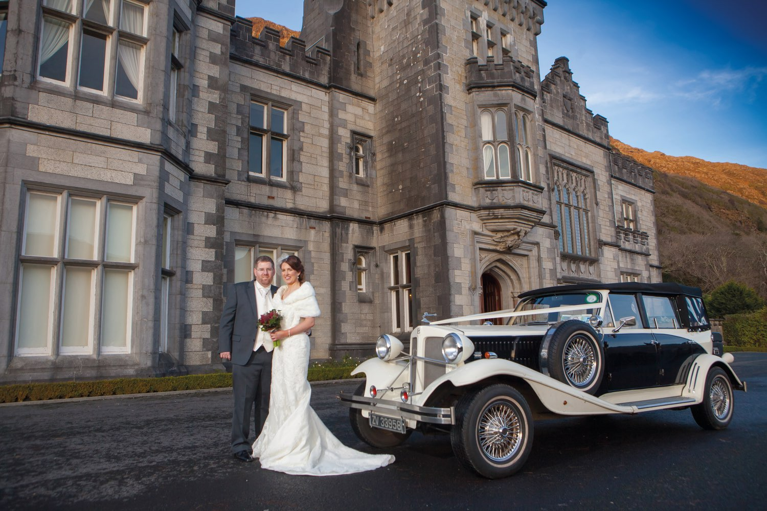 Ann-Marie Aspell and Tom O'Neill pose in front of Kylemore Abbey on their wedding day