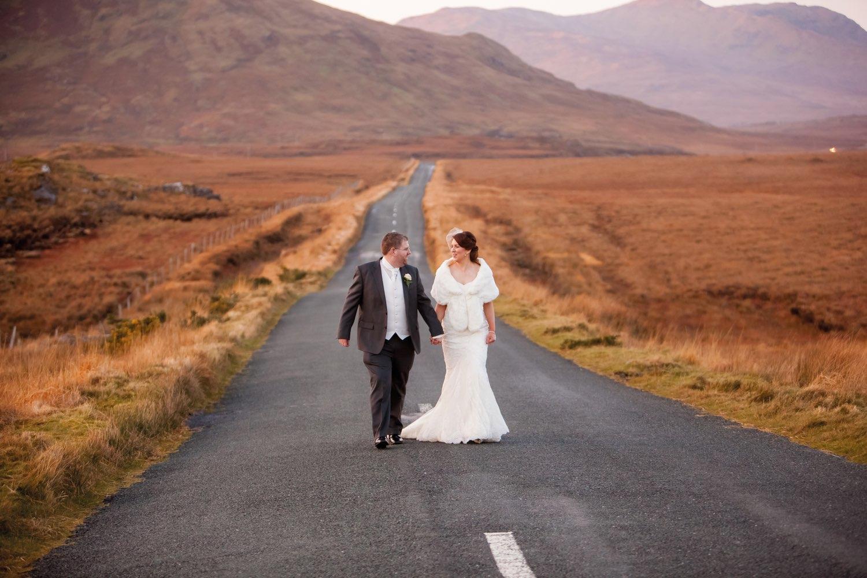 Ann-Marie Aspell and Tom O'Neill walking hand in hand along a winding Connemara road