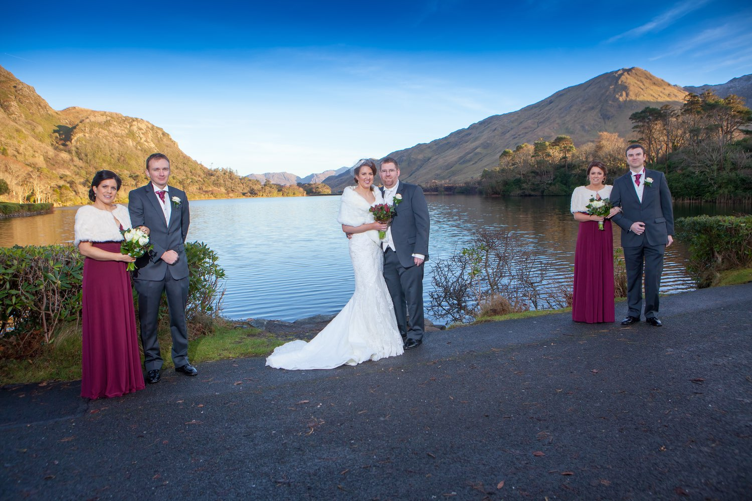 Ann-Marie Aspell and Tom O'Neill and bridal party pose in front of a Connemara landscape