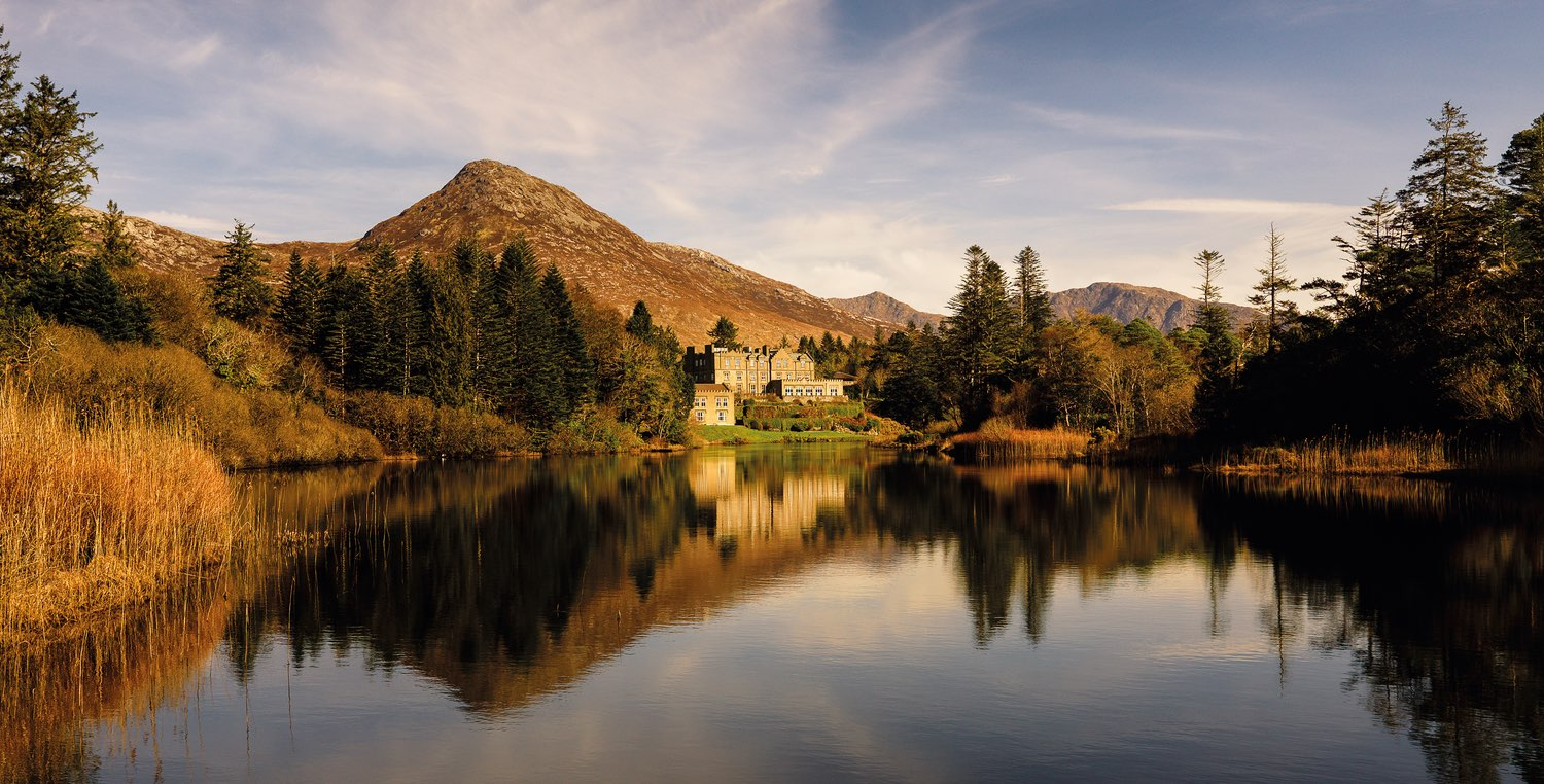 Ballynahinch Castle nestled between the Owenmore River and the mountains of Connemara. Photo courtesy of Ballynahinch Castle