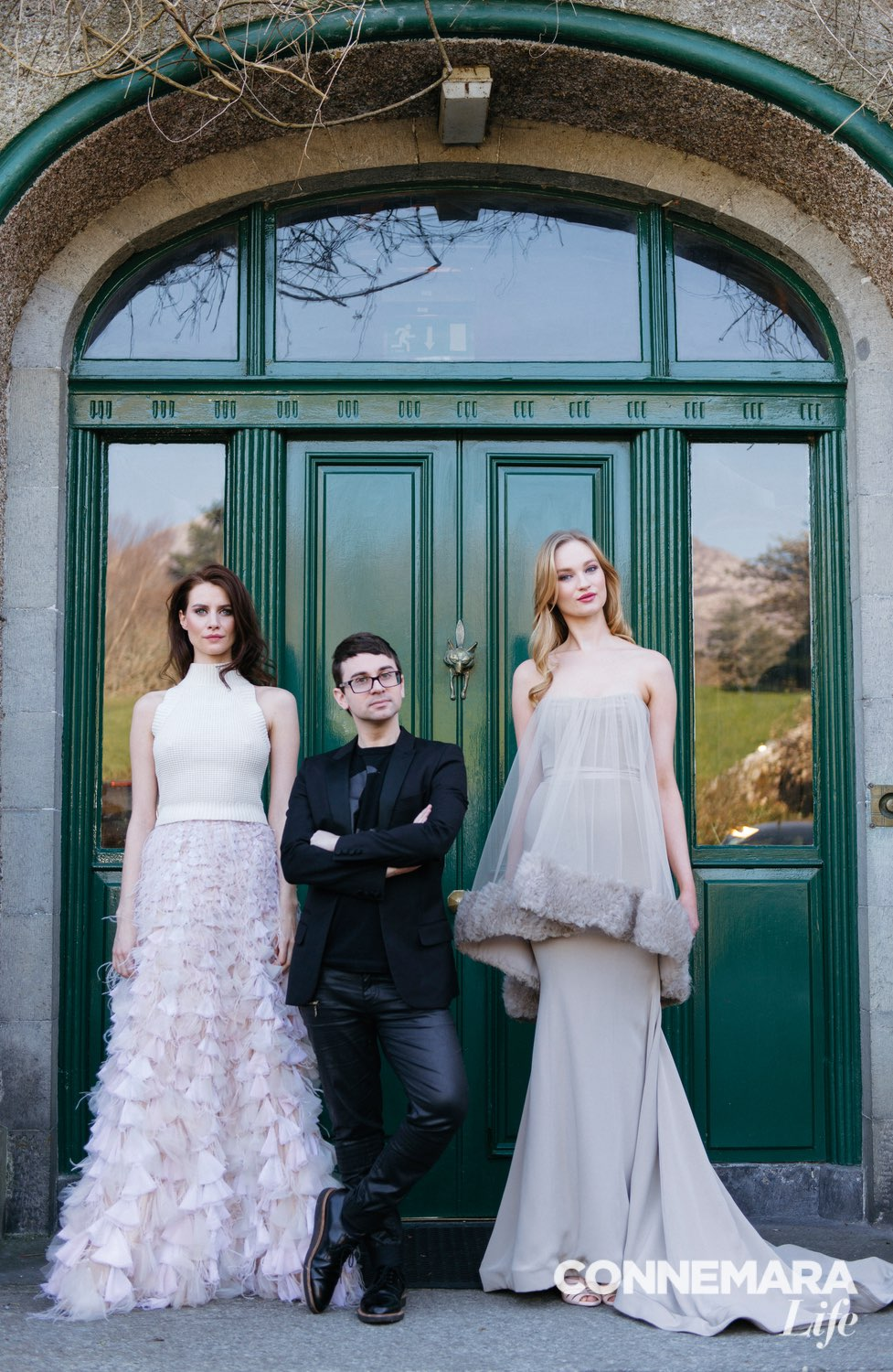 Models Faye Dinsmore and Clara McSweeney with designer Christian Siriano at Ballynahinch Castle entrance
