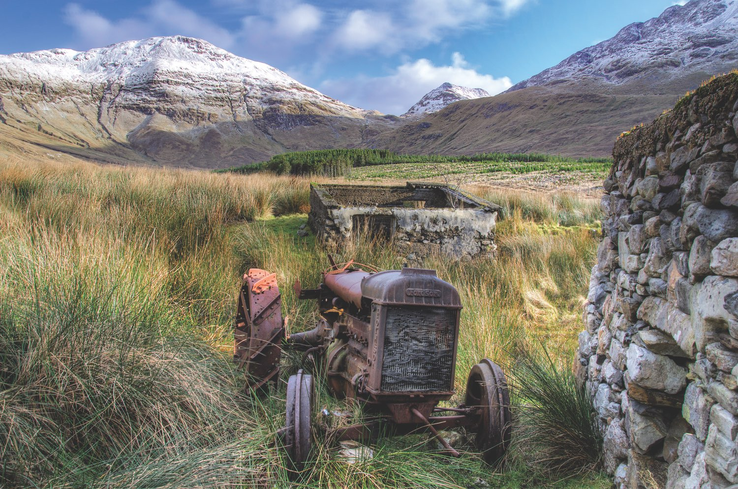 """""""After a nice hike through the bog I spotted this cottage and went for a closer look. I spotted the old Fordson tractor and knew this would make an interesting focal point to amazing mountains in the background."""" Taken at the foothills of Benbaun in Connemara. Photo by Trevor Dubber"""