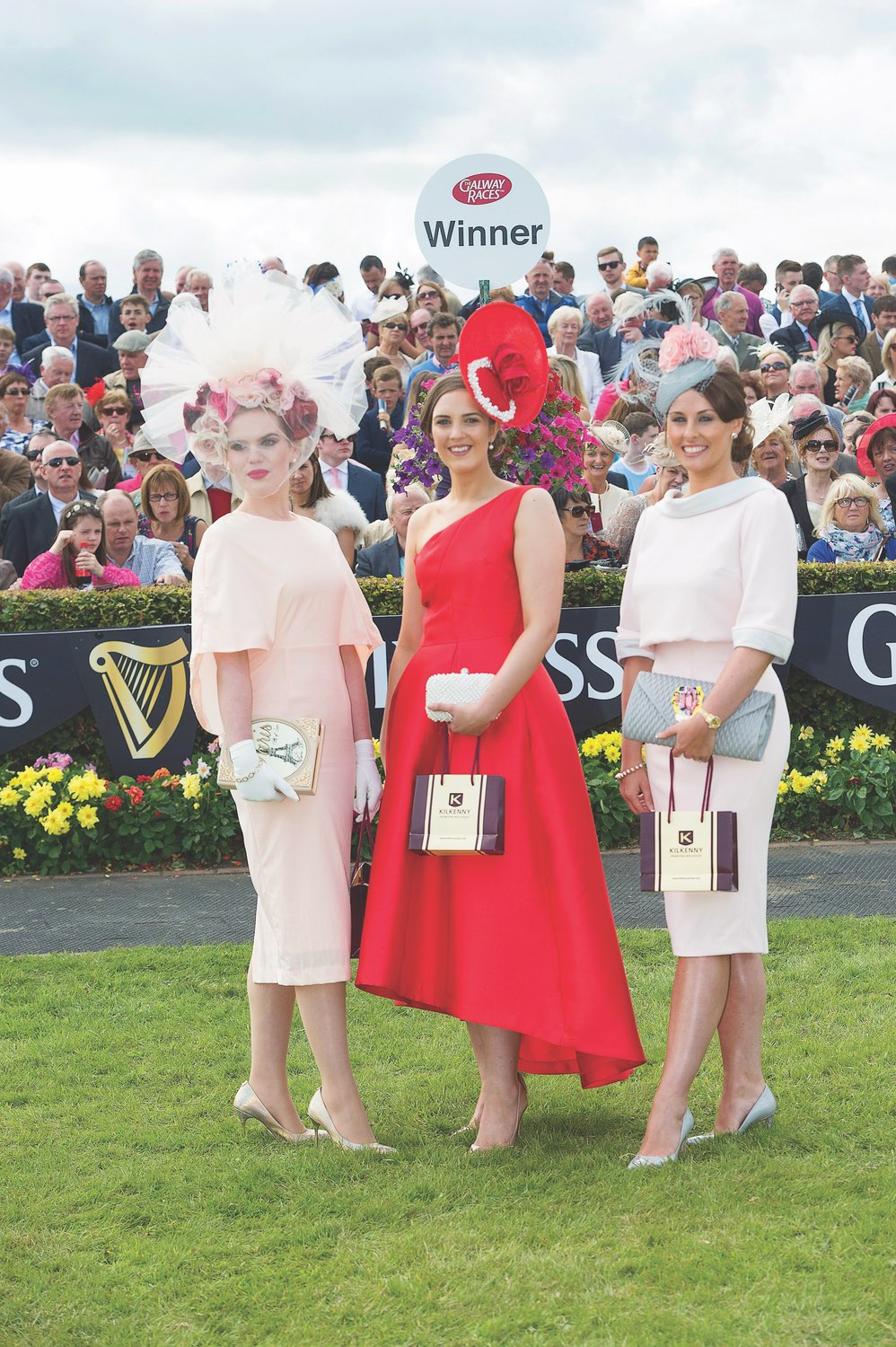 Alex Butler (middle)from, Co. Cork scooped the coveted title of Best Dressed Lady at the 2015 Galway Races Ladies Day, accompanied by Danielle Gingell (left) and Mary White (right).