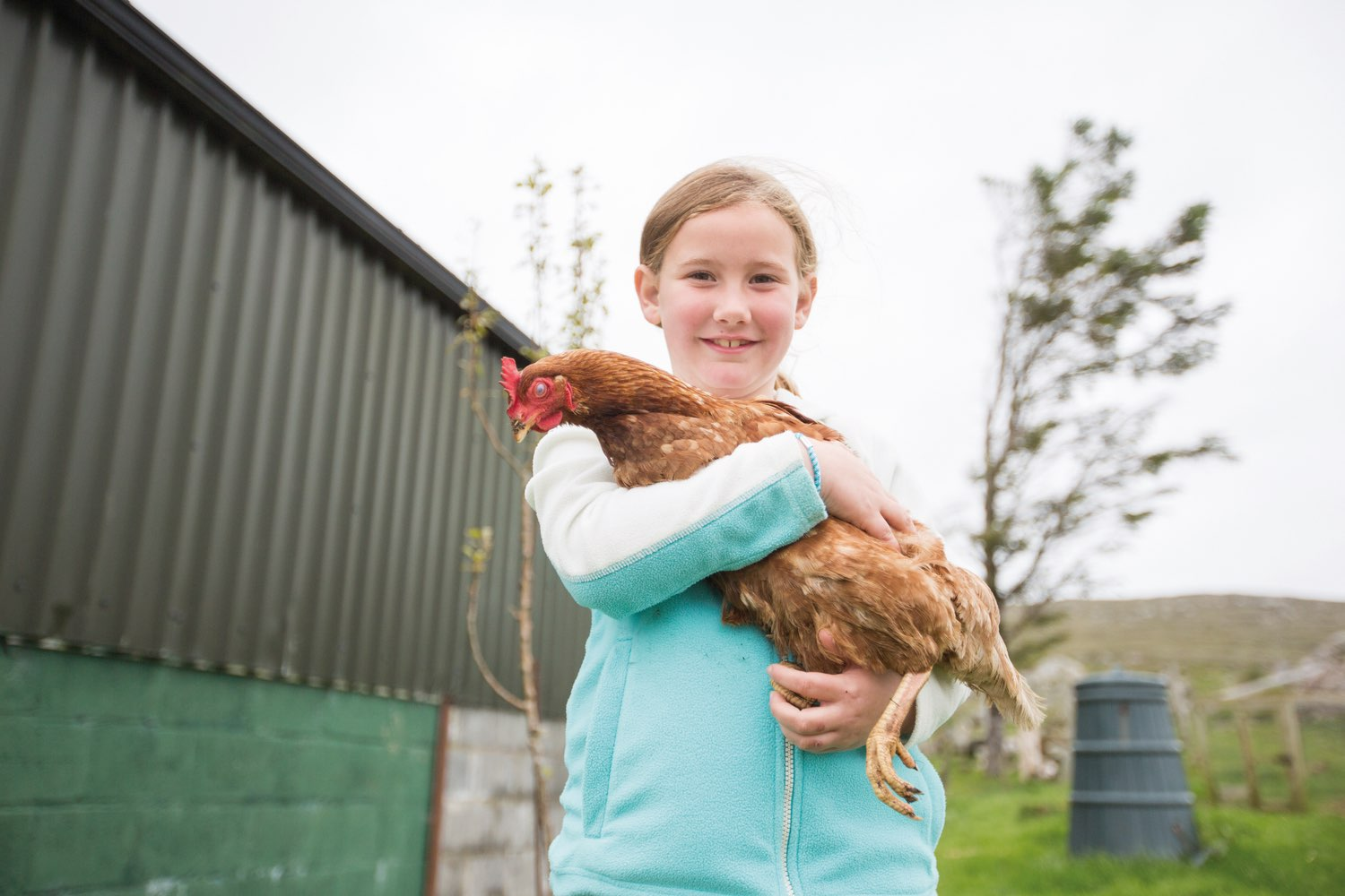 Gorham daughter holds onto chicken that is raised on their farm