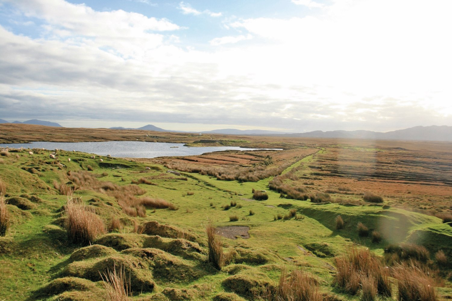 The Derrygimlagh landscape offers breathtaking views spotted with tiny lakes and peat bogs.