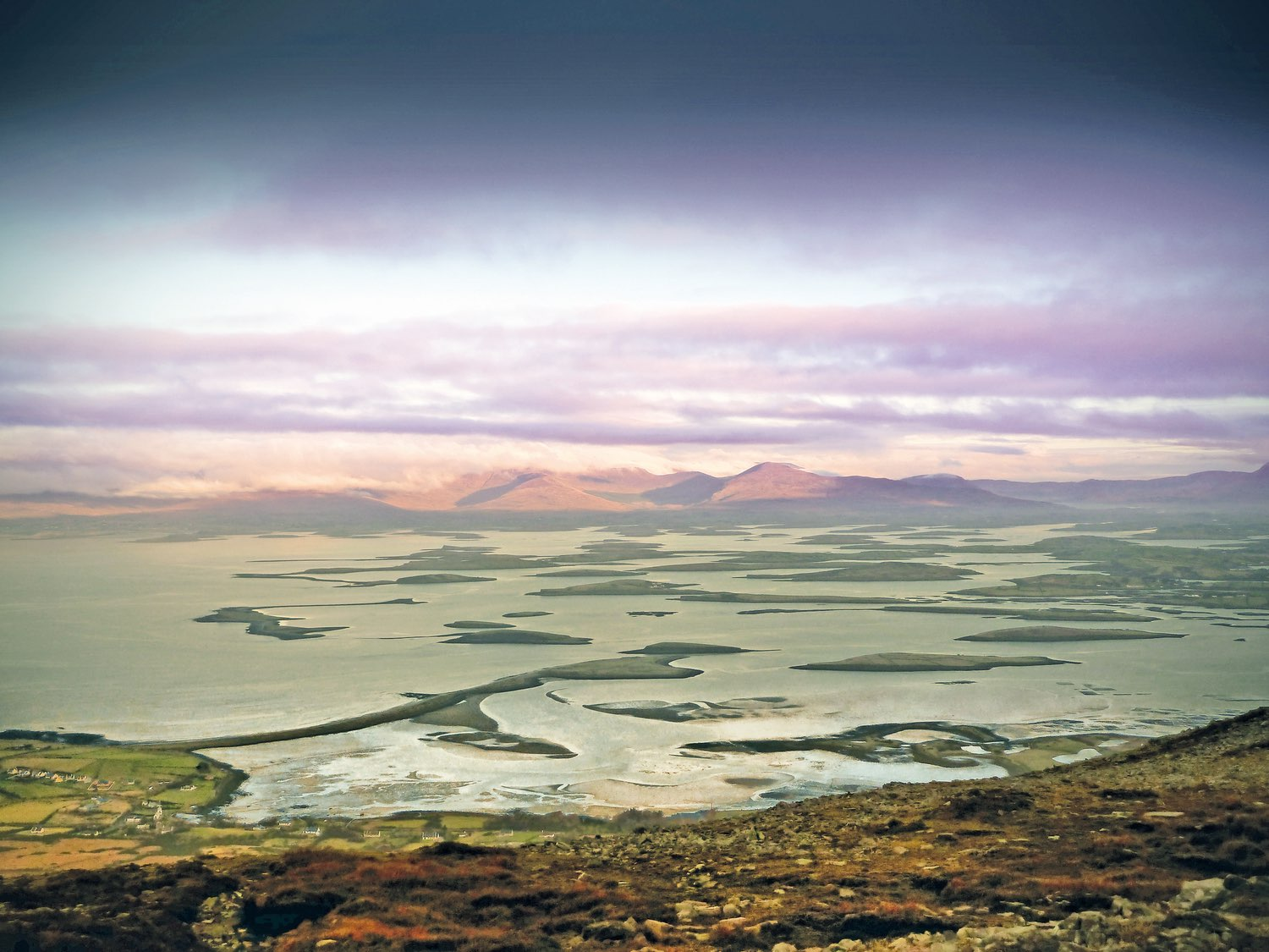 A view of Clew Bay from Croagh Patrick overlooks Dorinish Island (which once belonged to John Lennon), the village of Murrisk, and Bertra Beach.