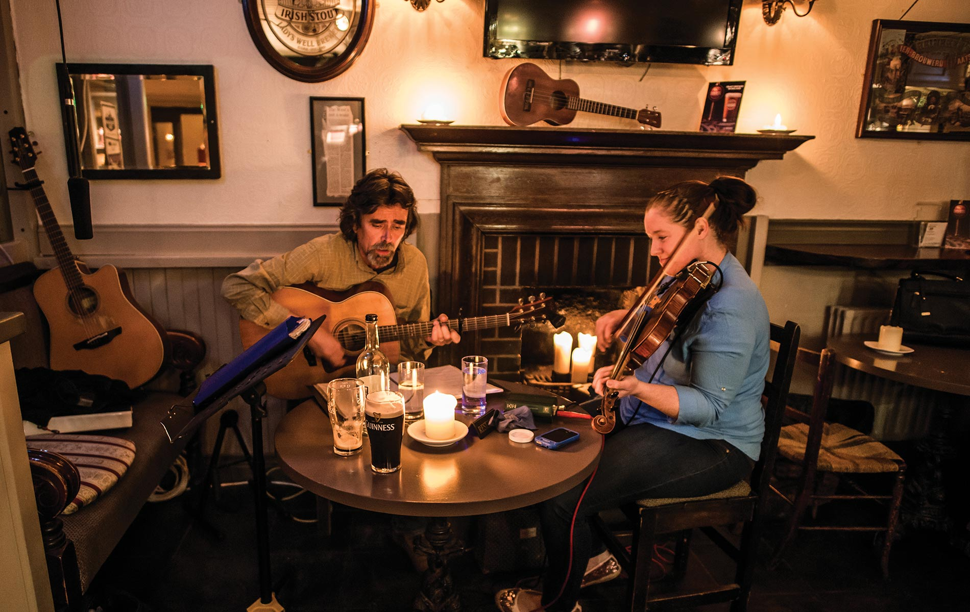 Couple playing music in Irish pub