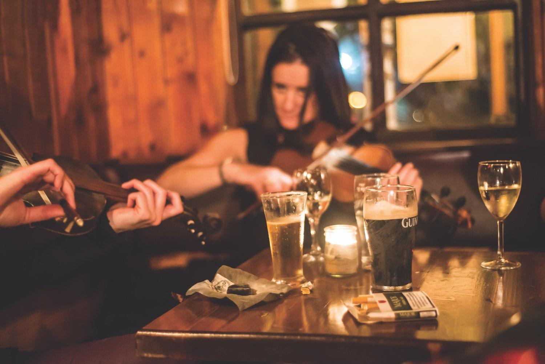 Woman playing fiddle in Irish pub