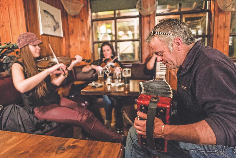 Gathering in Irish pub playing instruments