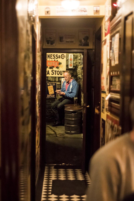 Man sitting in pub in Ireland