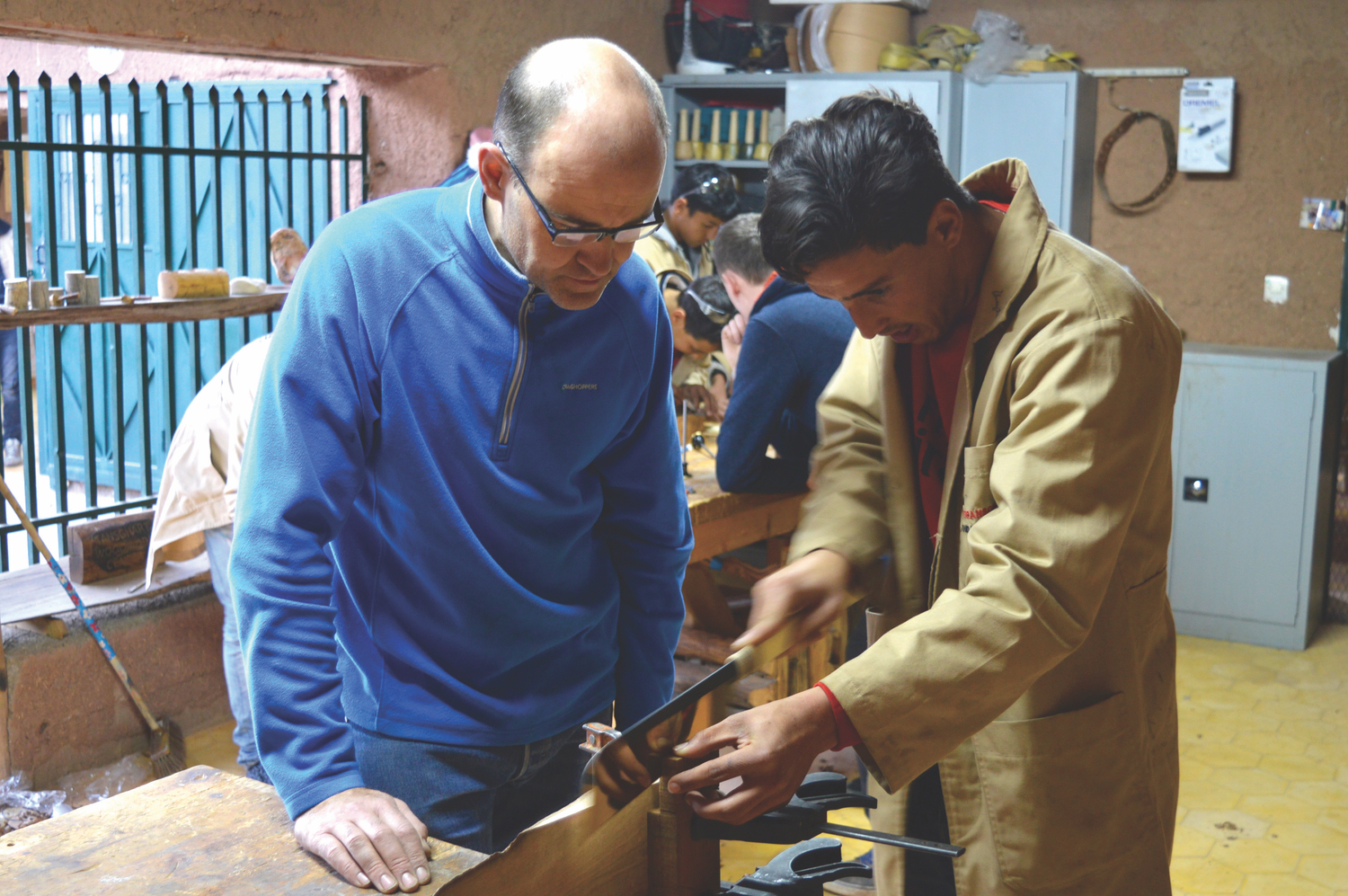 Paul Leamy working with Houssein, who is developing hand tool skills