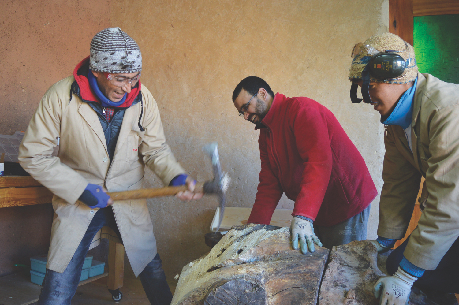 Mohamed, Abdelkbir and Mouad shaping reclaimed timber for the giant duck carving; Photo by David Bult