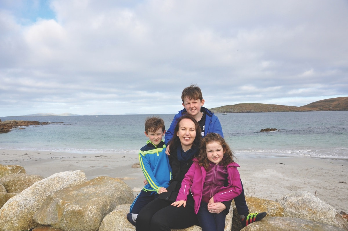 Marie Feeney with her children—Ronan, Diarmuid, and Michaela.