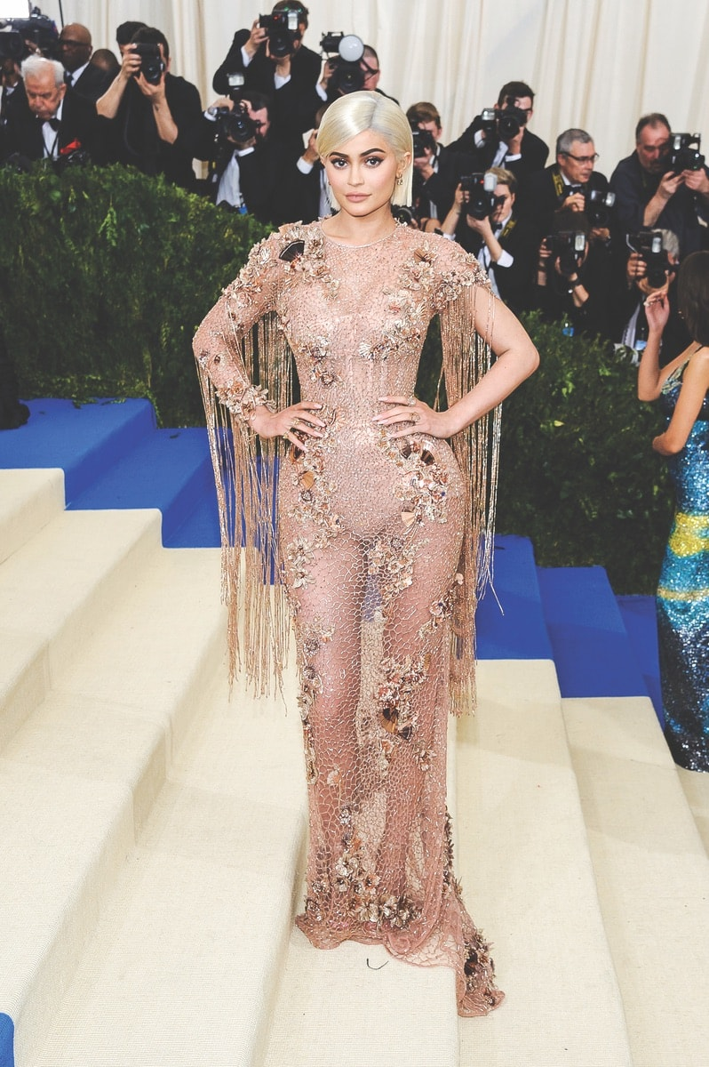 Kylie Jenner attends the 2017 Metropolitan Museum of Art Costume Institute Gala in New York City sporting a platinum blonde wig.  Photo by Sky Cinema/Shutterstock