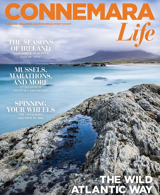 "This #TravelTuesday, we're reminiscing about our 2015 inaugural issue of @connemaralife! | ""The photo was taken in early May of 2015 while I was walking my dog, Iggy, along Renvyle Beach. Photography wasn't my primary reason for being out and about that day; however, the photographer in me is always prepared. The clouds rolling over the hills in the distance and the turquoise Atlantic Ocean inspired me to scramble over the rocky pools, set up the camera, and take a few shots while Iggy waited impatiently on the beach."" — @markfurnissphotography, photographer 