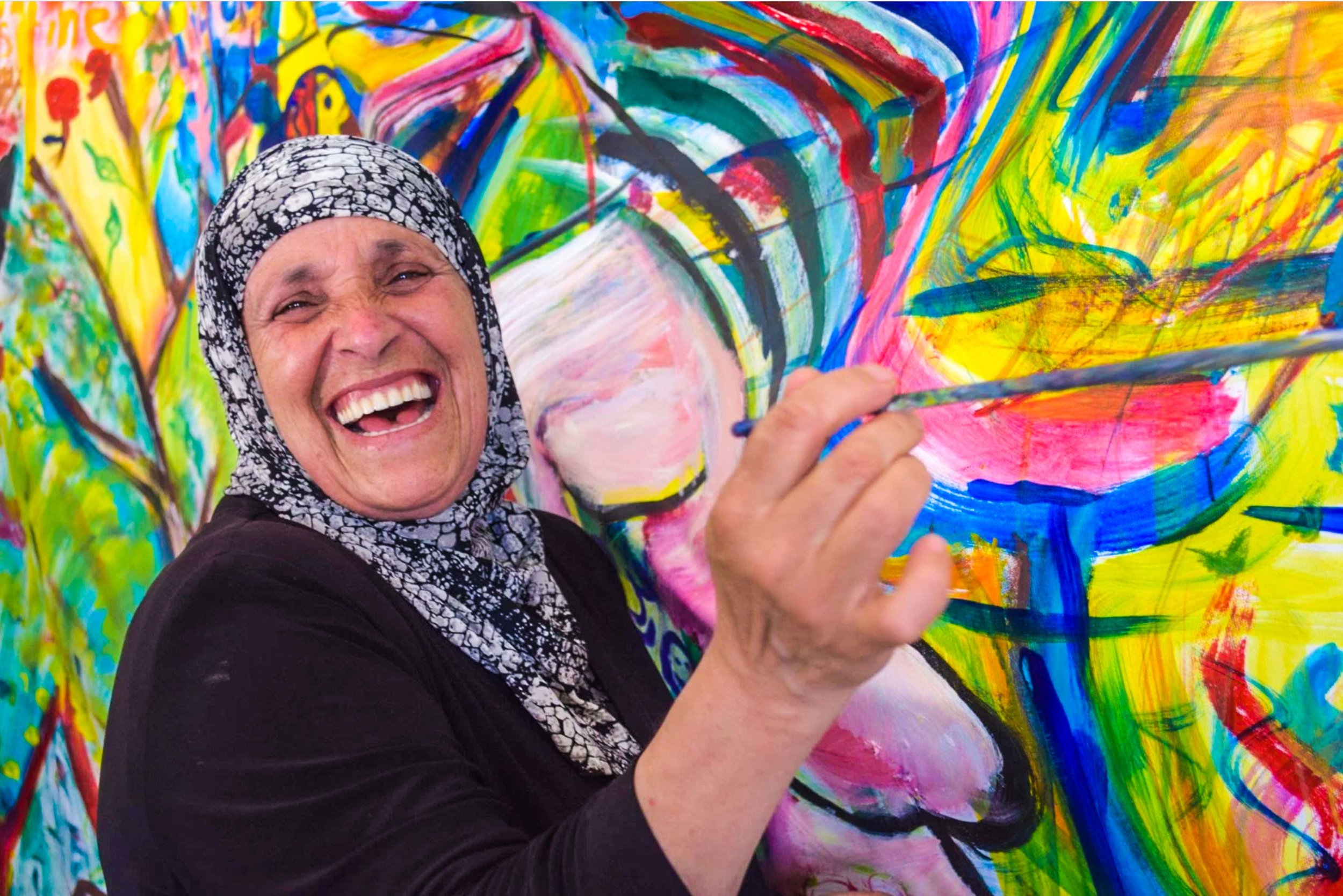 Palestininan woman with paintbrush low res.jpg