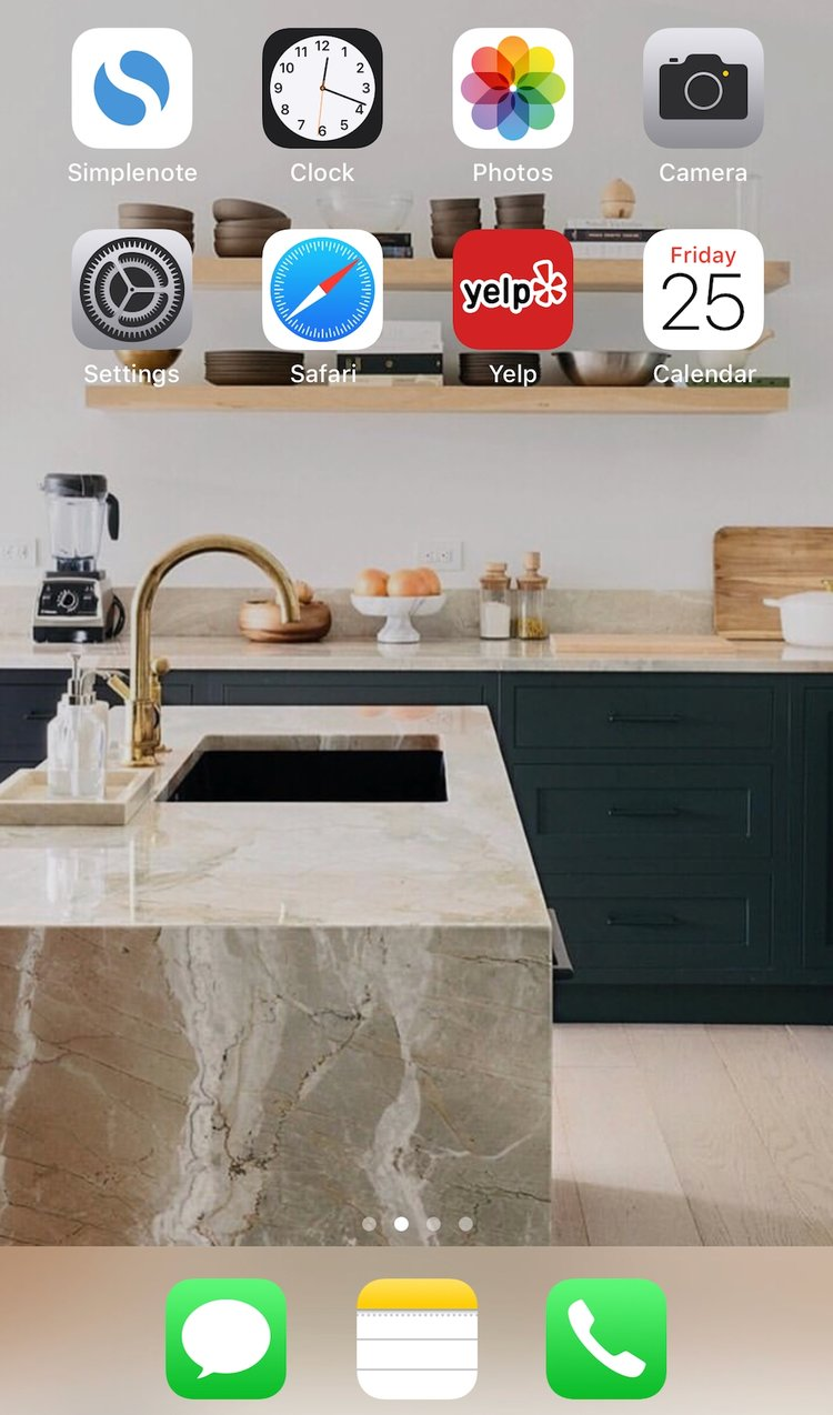 "My phone home screen. Only ""essential"" apps, no notifications, and my dream kitchen as the background. I feel happy and at ease when I see it."