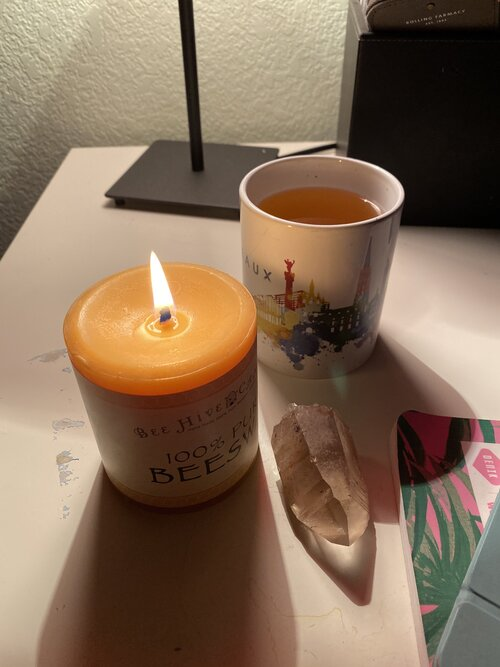 A sneak peak into my evening routine. Candles, tea, crystals and meditation.