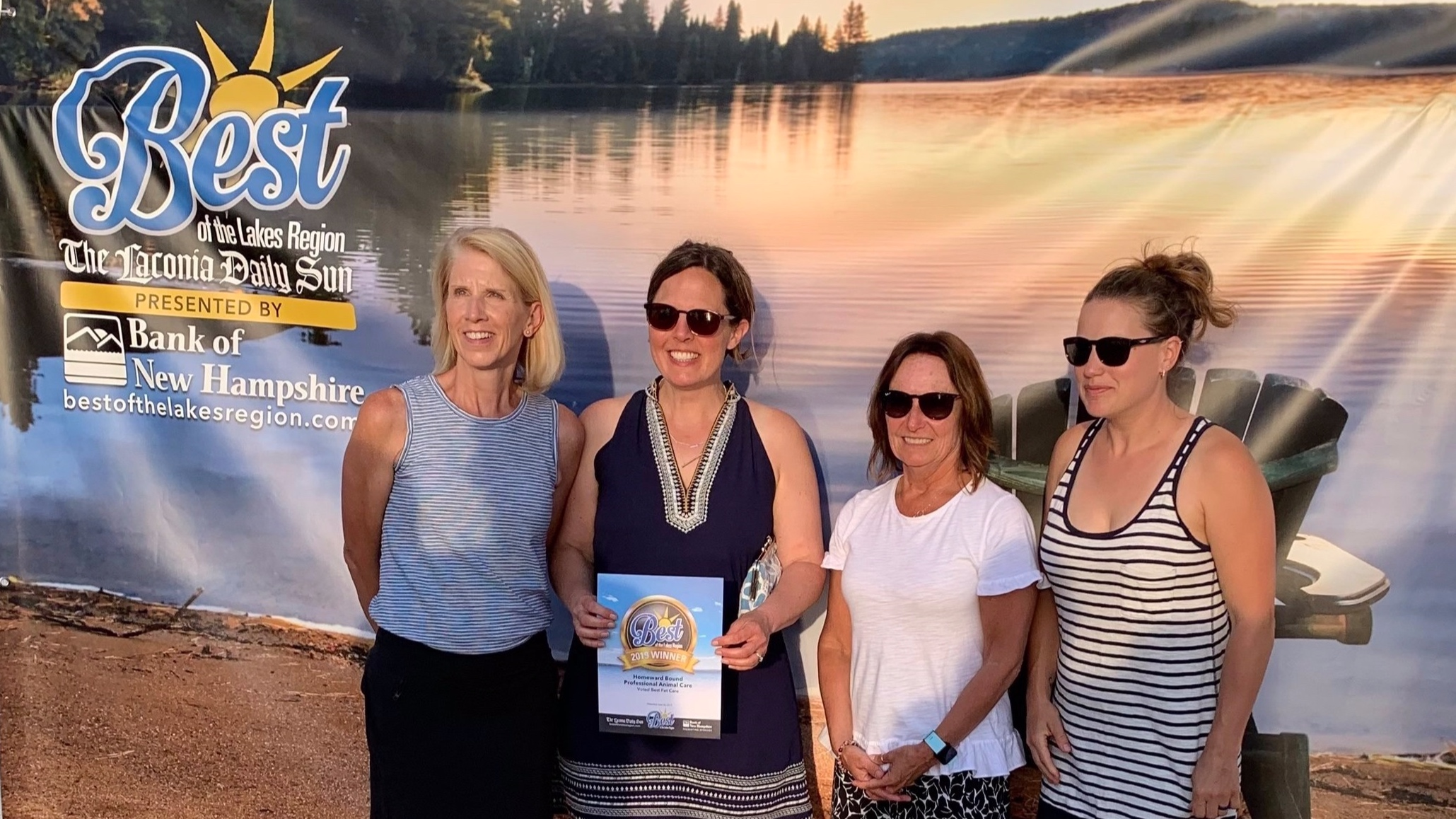 Homeward Bound employees, along with owner Alix, accept Best of the Lakes Region Award at the Best of the Lakes Region Beach Party. From L to R: Jane, Alix, Lee, and Emily.