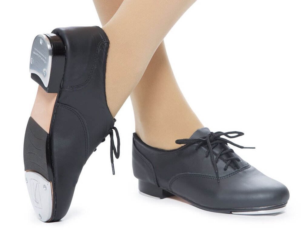 Tap - Rhythm & Broadway Tap:-Sweats, leggings, or well-fitting shorts-T-shirt or tank top-Black Oxford (lace-up) Tap shoes-Hair pulled up securely into a ponytail or bunImage from Revolution Dancewear