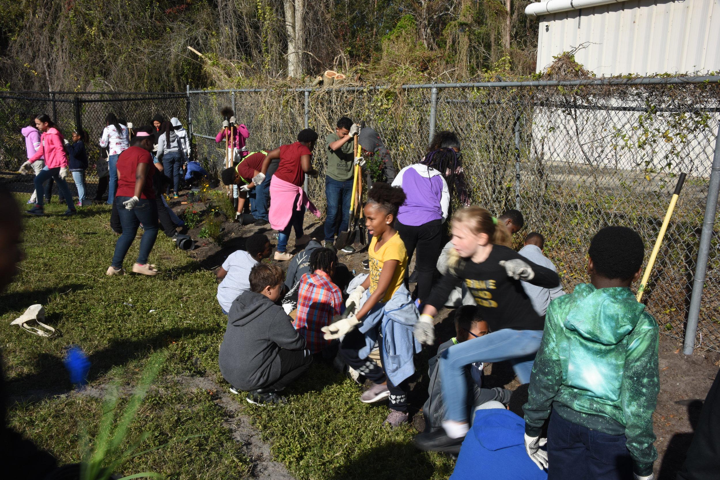 Student volunteers planting pollinators, photo courtesy of City of Orlando