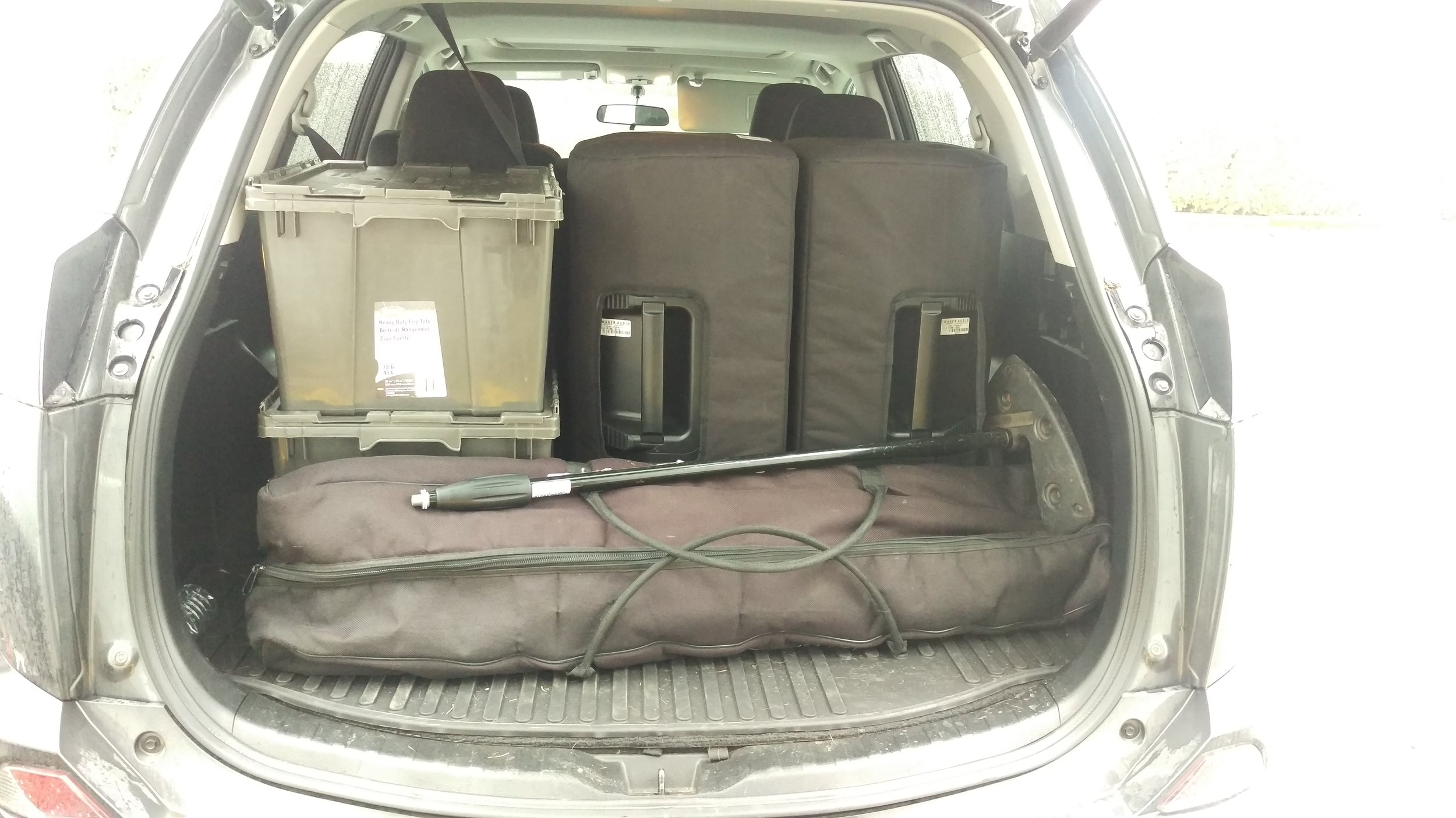 Two Powered Speakers w/ Mic package in the back of a Toyota Rav4
