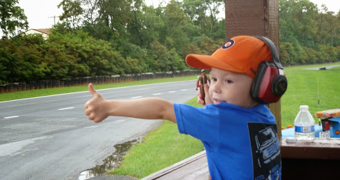 WINNER: Jeanne Burton Fryer - Young boy with thumbs up at a MARRS race.