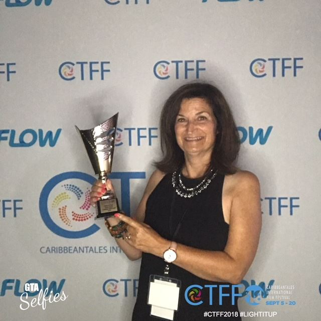 Gayle Wilmot accepts the Caribbean Spirit Award at the Caribbean Tales Film Festival
