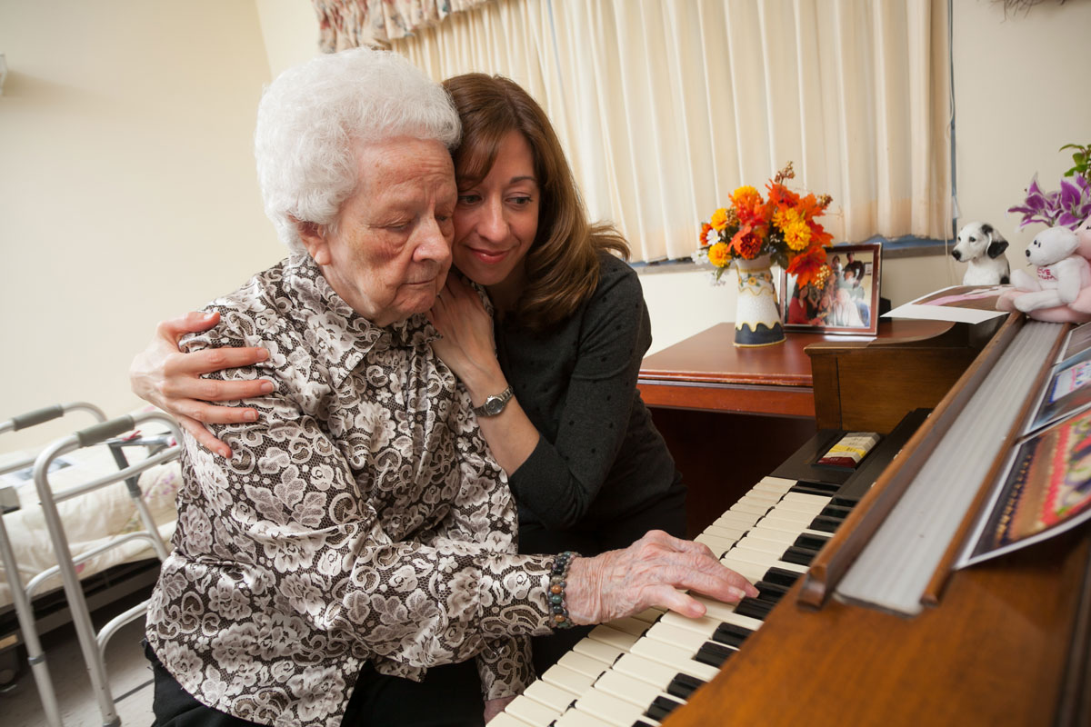 Alzheimer resident and grand-daughter in senior home