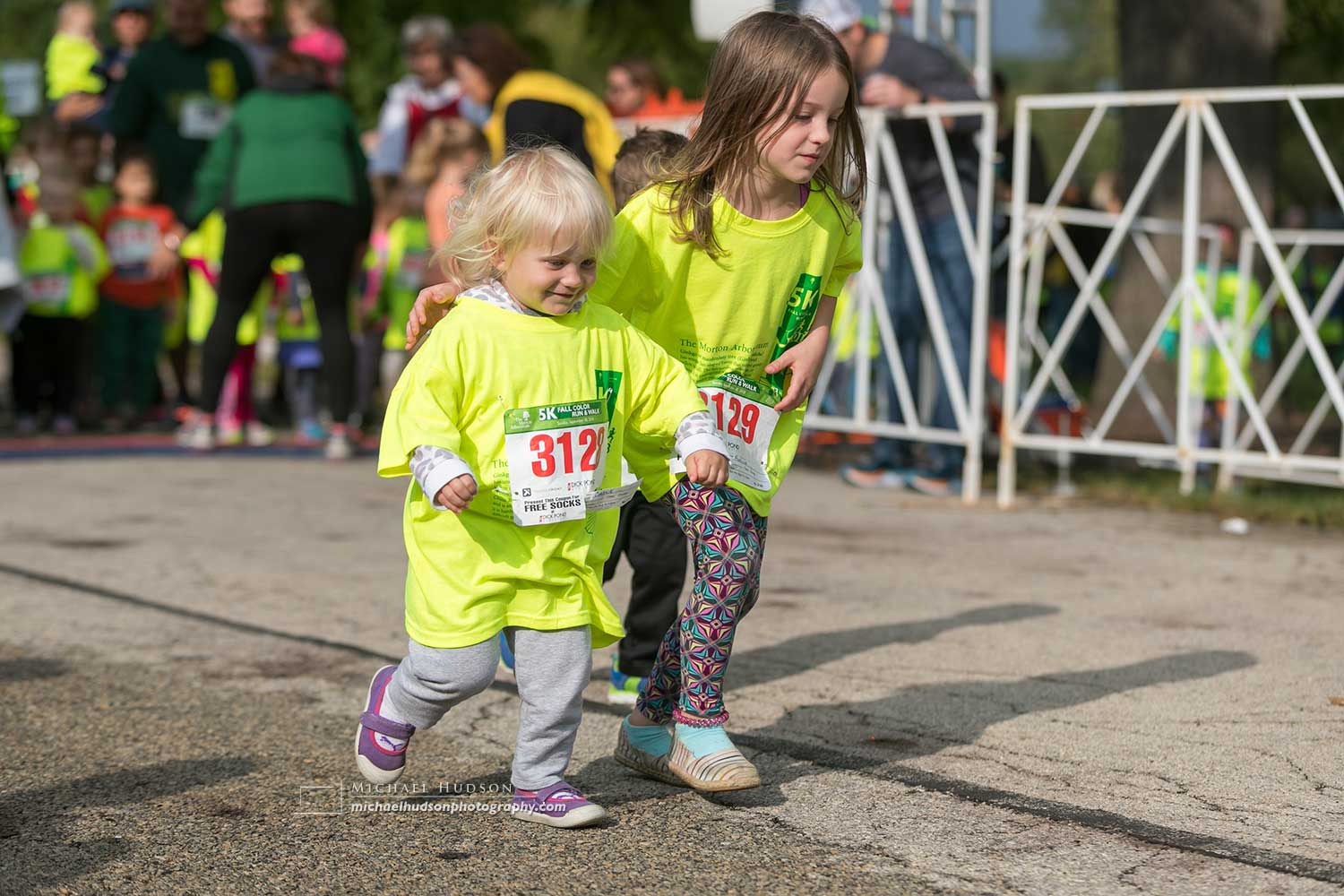 My favorite picture of the day, when one little girl was left behind by all the other kids. Then her sister came up behind her, put her arm around her and ran the rest of the race as her guide.