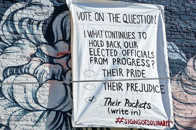 What continues to hold back elected officials from progress?? Vote on this question and consider how real progress is made. Banner by:Fatima Stephens  Photo by: @naptimehacker  #signsofsolidarityatl #voteatl2017