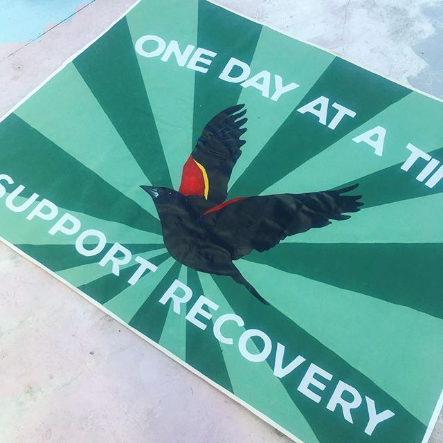 """""""Support Recovery""""  Coming together locally we can  Increase access to effective treatment in our city.  increase awareness and understanding of mental and substance use disorders.  Promote emotional health and wellness!  Banner by @alisonhamilart  #signsofsolidarityatl"""
