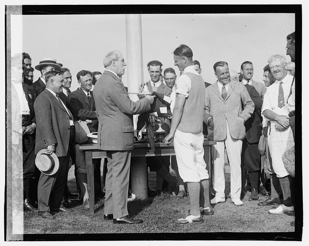 """Photo shows Charles Evans Hughes and Righard """"Dick"""" Walsh; James D. Standish, Jr., can be seen on Walsh's right. Taken at the Second Annual American Public Links championship golf tournament held at East Potomas Park, Washington, D.C. (Source: Chicago Tribune, June 30, 1923."""