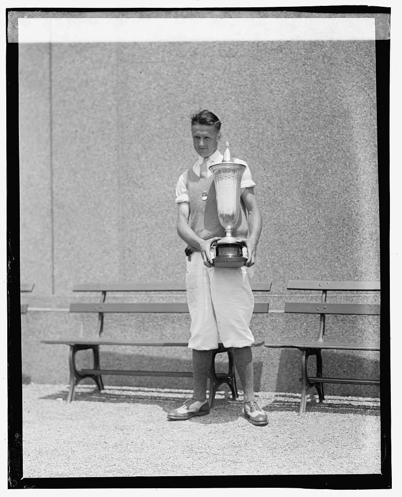 """Photo shows Richard """"Dick"""" Walsh holding the Standish Cup. Taken at the Second Annual American Public Links championship golf tournament held at East Potomac Park, Washington, D.C. (Source: Chicago Tribune, June 30, 1923)"""