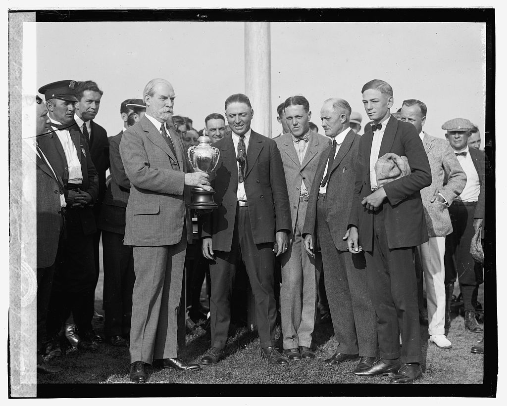 Photo shows Charles Evans Hughes presenting the Harding Cup to the Chicago team at the Second Annual American Public Links championship golf tournament held at East Potomac Park, Washington, D.C. (Source: Chicago Tribune, June 30, 1923.