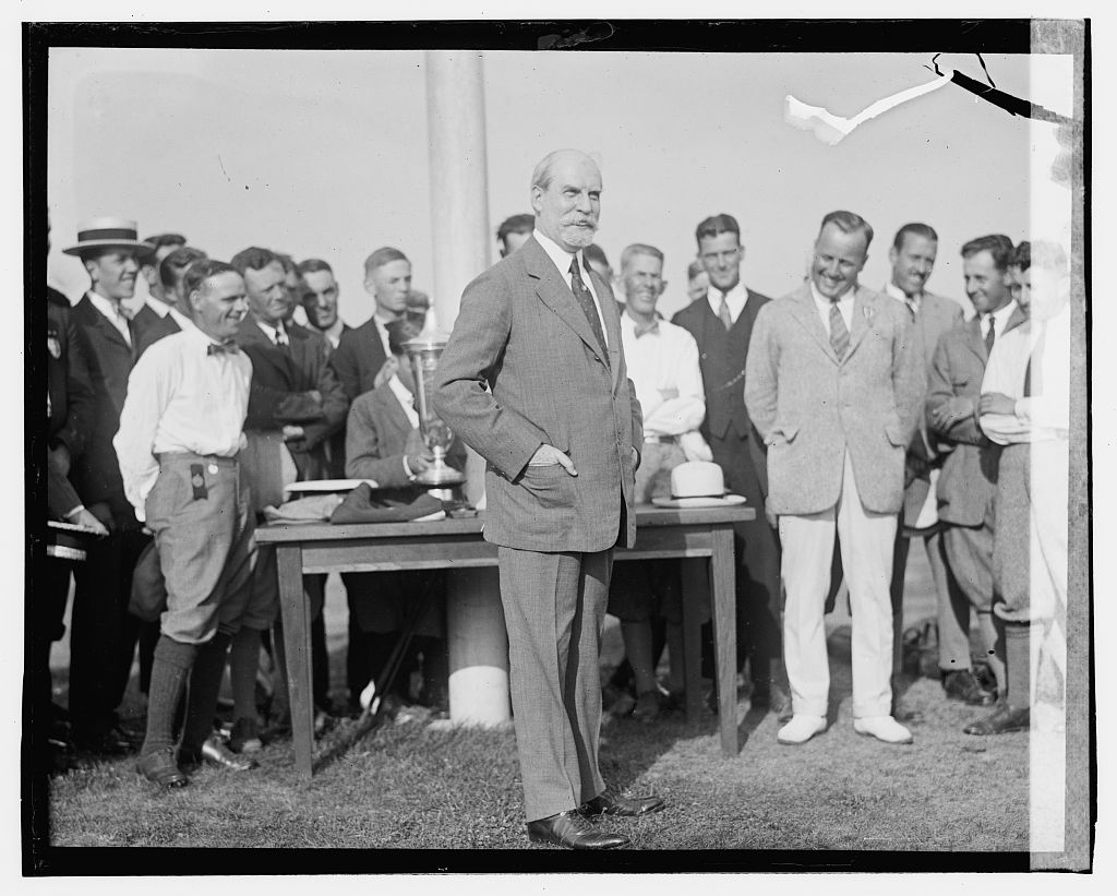 Photo shows Charles Evans Hughes; James D. Standish, Jr., can be seen to his right. Taken at the Second Annual American Public Links championship golf tournament held at East Potomac Park, Washington, D.C. (Source: Chicago Tribune, June 30, 1923)