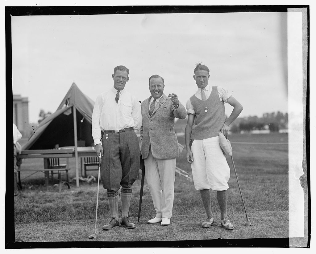 J. Stewart Whitham, left, runner up in golf tournament, J.D. Standish, Jr., center, [...] Michigan donor of Cup, and Dick Walsh, of New York, winner of cup of Nat'l Public Park Golf Tournament