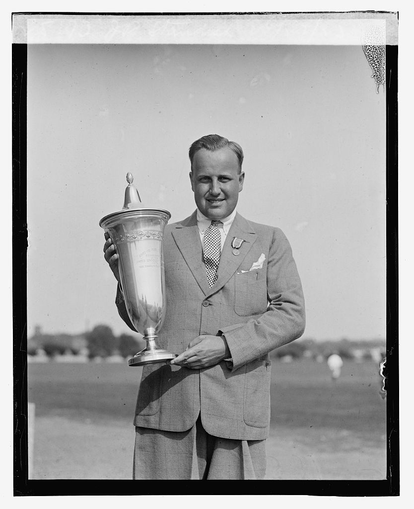 Photo shows James D. Standish, Jr., holding the trophy that bears his name, the Standish Cup. Taken at the Second Annual American Public Links championship golf tournament held at East Potomac Park, Washington, D.C. (Source: Chicago Tribune, June 30, 1923)