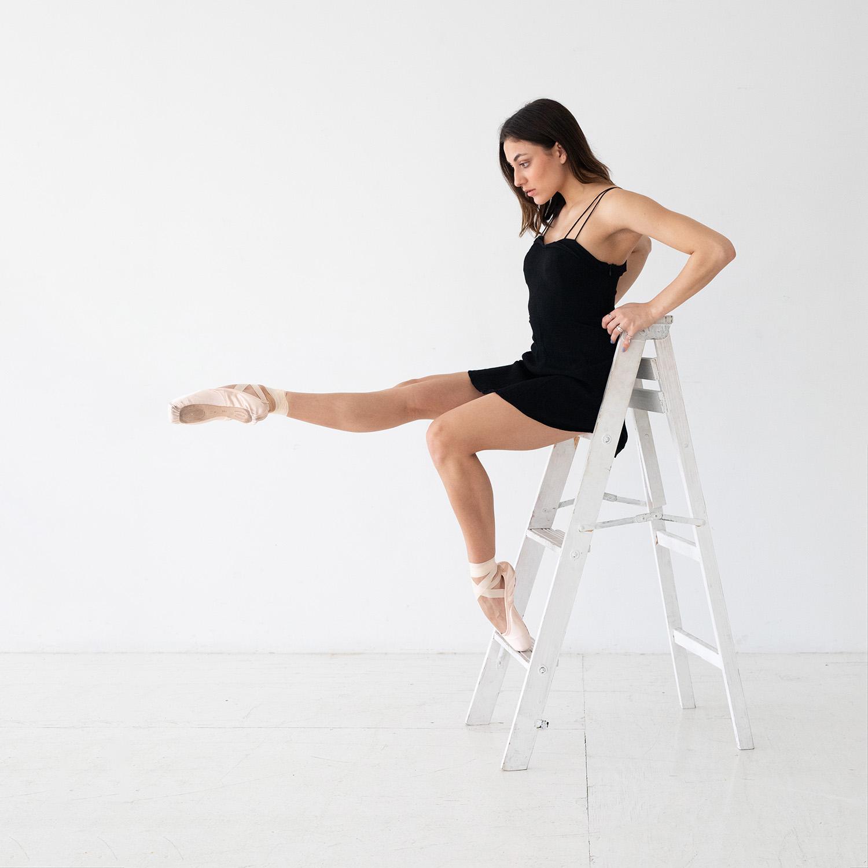 Ballerina Posing on a Ladder