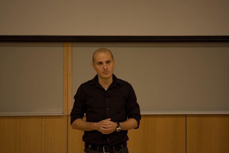 Cristian Mitreanu introduces a speaker.