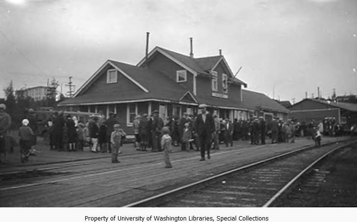 Railroad station with crowd of people waiting near tracks, Anchorage, Alaska, between 1930 and 1936.