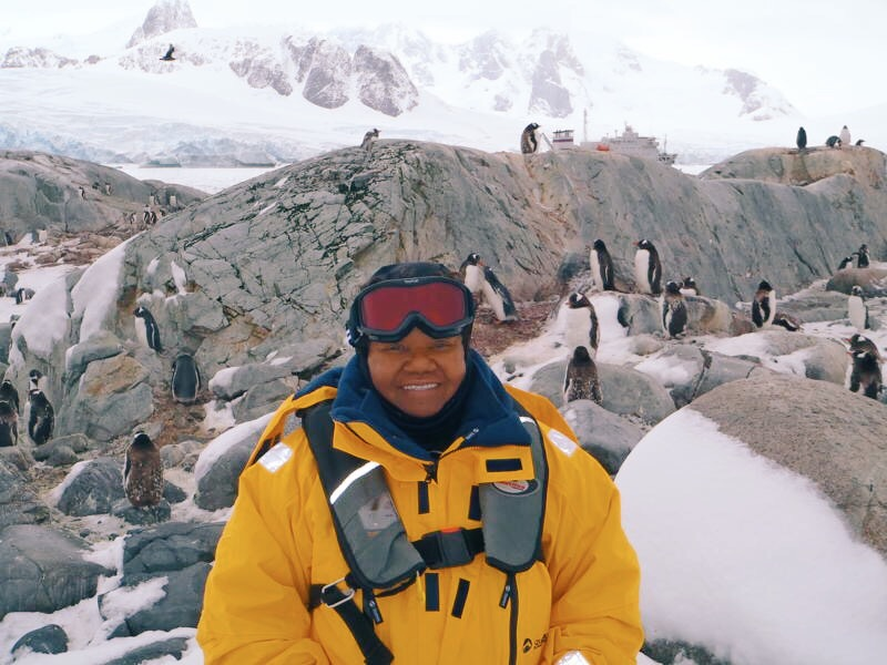 """Mama McNair in Antarctica. Literally called me one day and said, """"I'll be back. I wanna see some penguins."""" This is my favorite picture of her."""