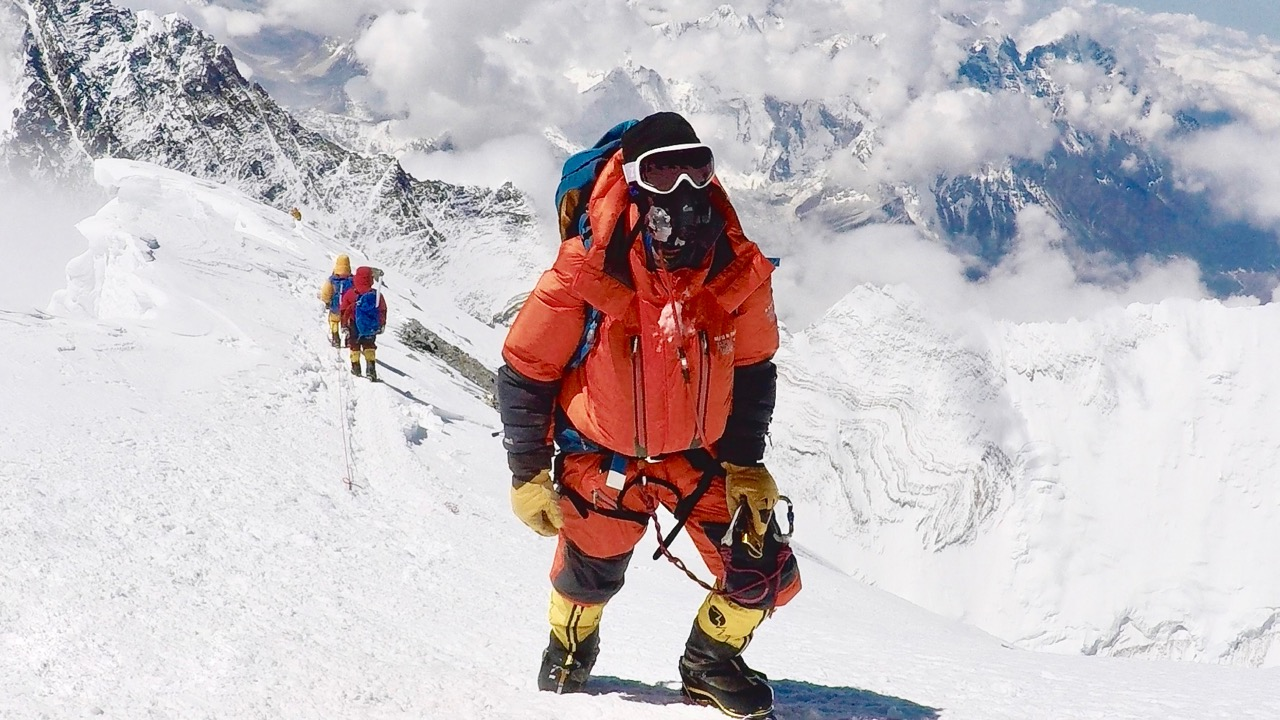 Chris taking final steps to summit.jpg