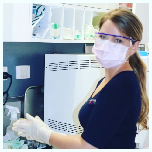 Nikita is the Senior Dental Assistant to Dr Amy Daley. Here she is preparing dental instruments for the autoclave as part of daily procures.