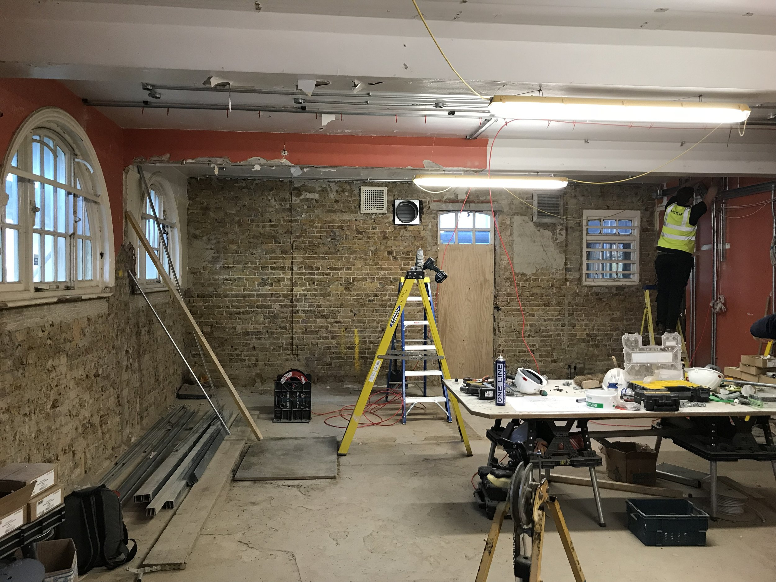 Works were carried out to make this space suitable for a cafe and bar. This involved removing later addition stud walls, removing mould and rot, revealing the parquet flooring and installing new services.