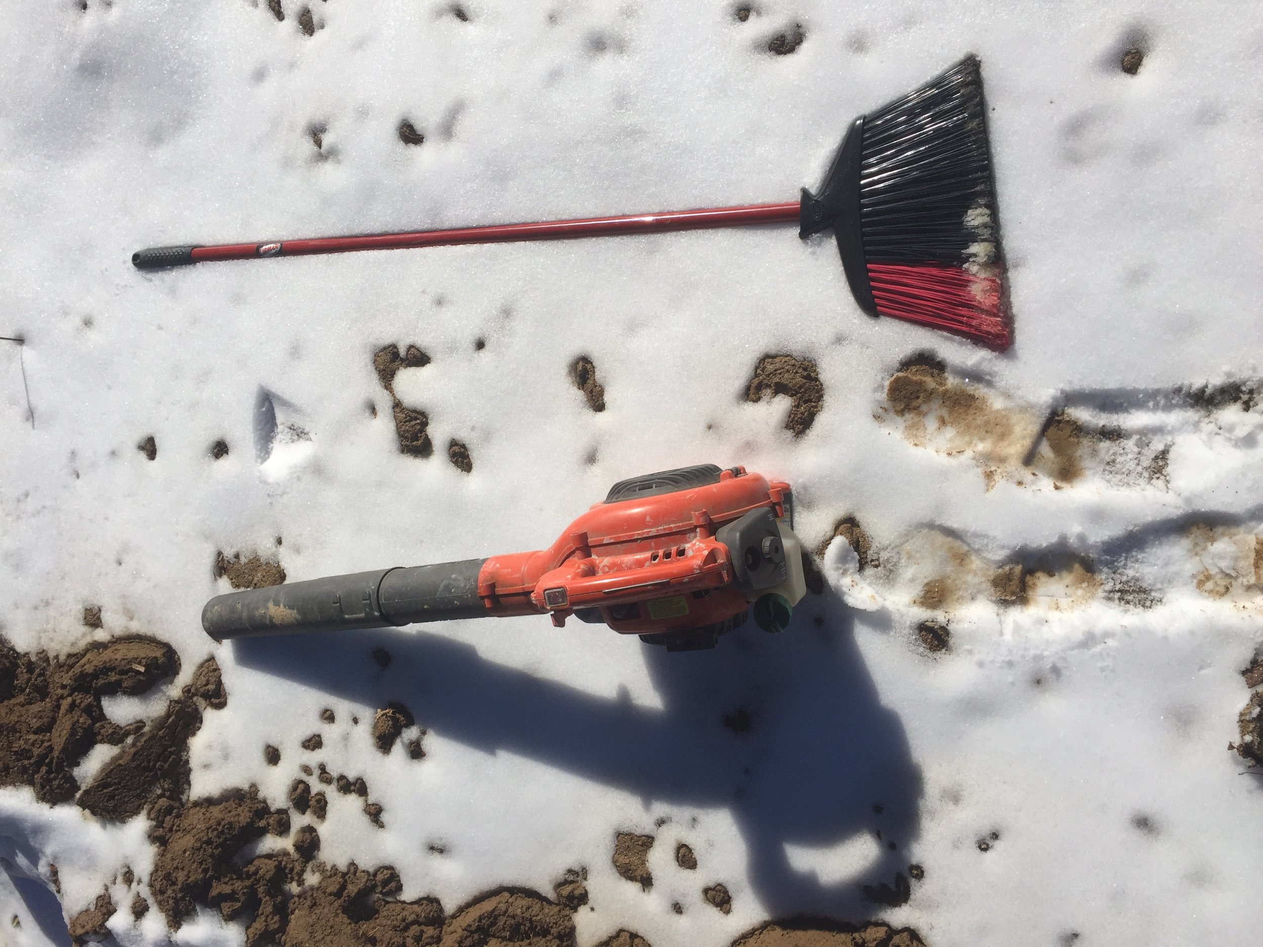 A broom and a leaf blower help clear away melting snow. But a light hand and a careful operator are also important!