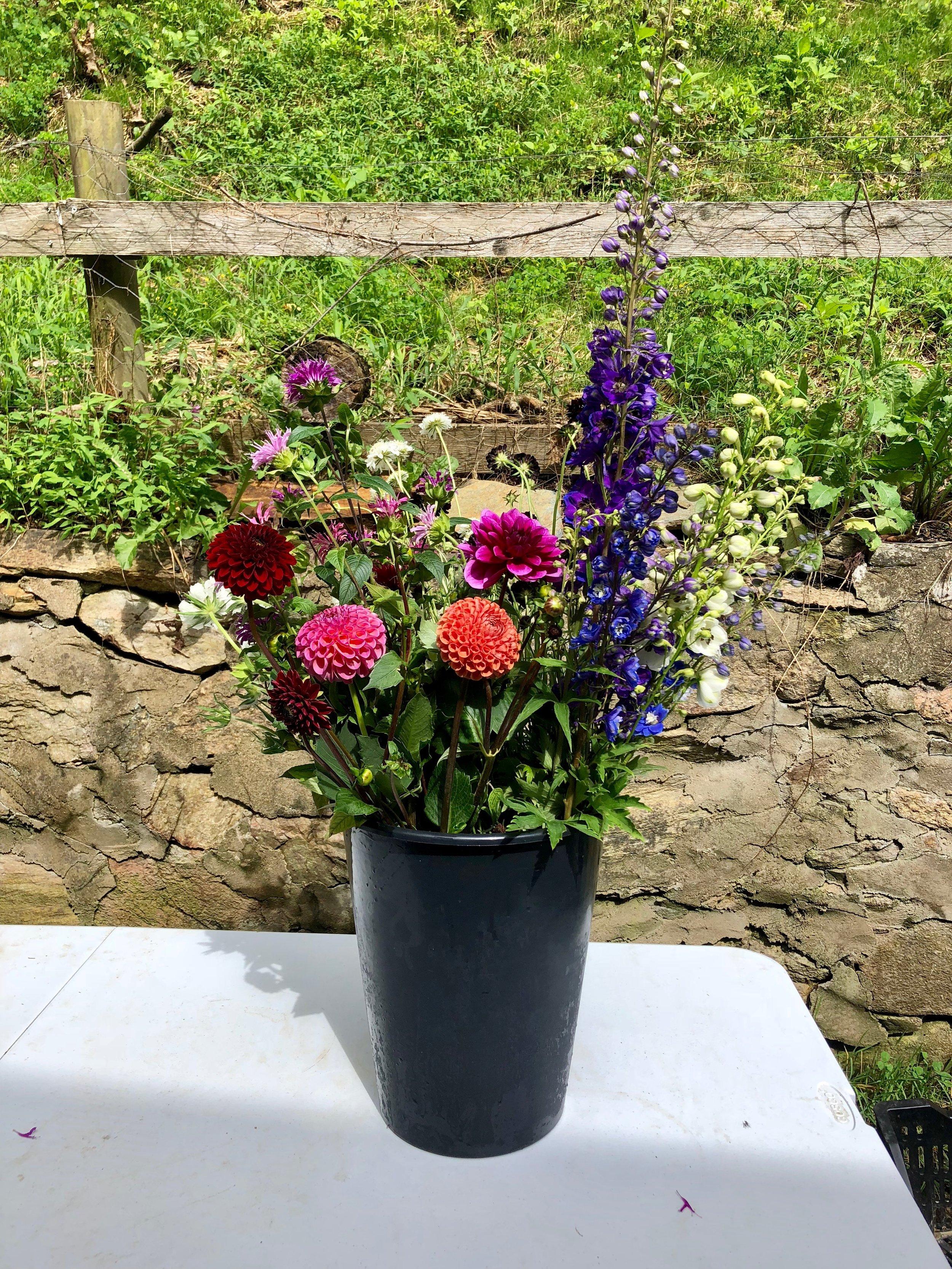 Bulk buckets of flowers