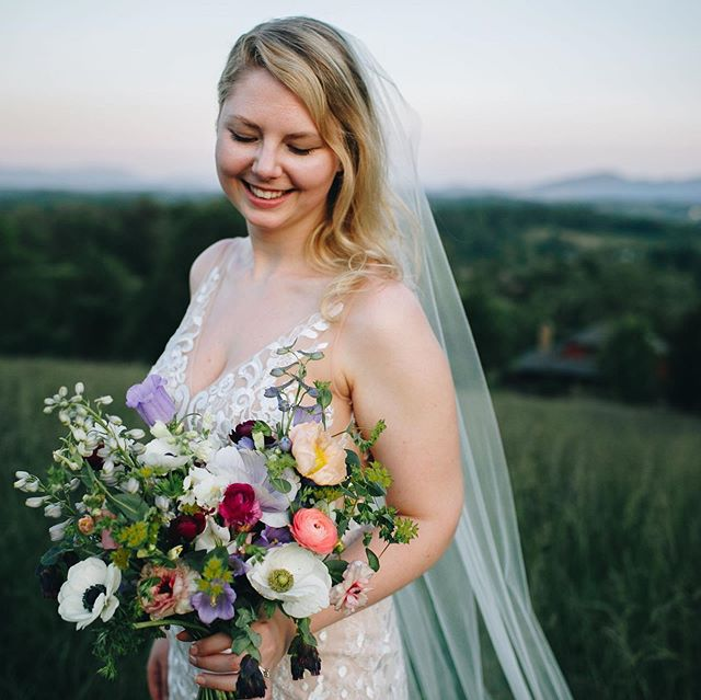 This bouquet had been down the aisle, lofted in the air, spun, cried over, hugged around, first looked and married, whispered behind, displayed on the head table — and then, wisely, returned to the bride's hand by @sheilamraz.photography to catch golden hour at @longleafvineyard. I love this photo because the light is so soft and lovely, and Kiana's pose is so relaxed and happy. There's always an anticipation before the ceremony that you can see in photos, and then watch I dissolve as the wedding unfolds. And I'm pretty proud my flowers are still Insta-worthy, even after a full day of festivities. Congratulations Kiana and Kyle! - Also worth noting, this bouquet was 100 percent farm grown!
