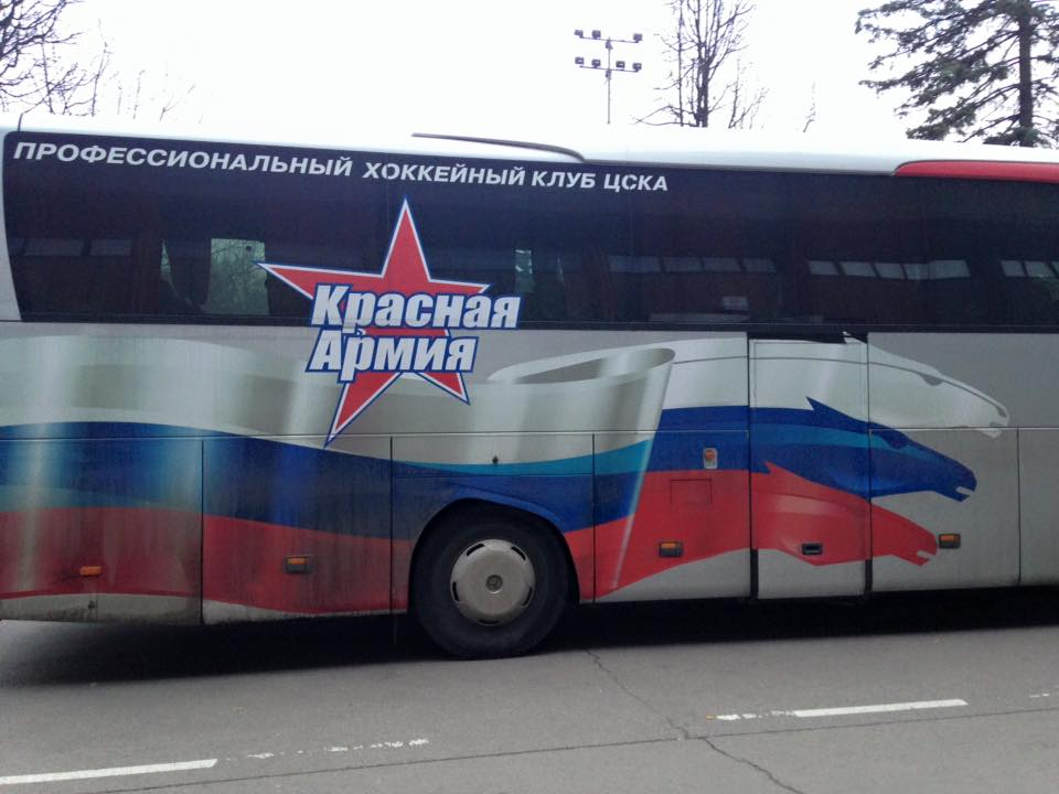 Yes, this is a bus for a Russian hockey team. It is unlikely to stop for you.