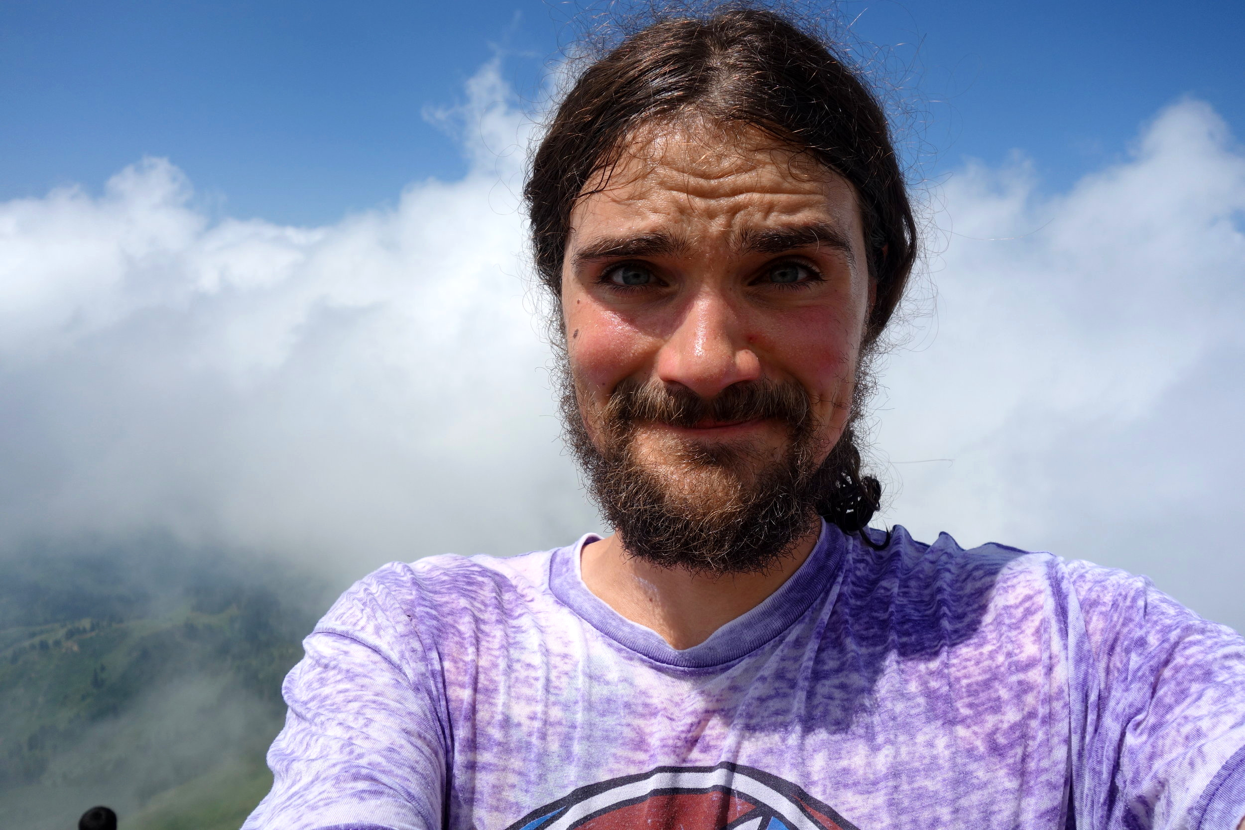 Top of a mountain, in the clouds and wearing a Grateful Dead shirt. The Life.